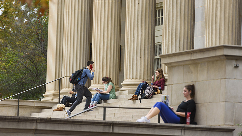 Students studying on the steps of Gorgas Library